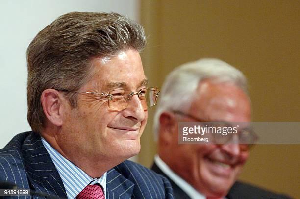 HypoVereinsbank Chairman of Supervisory Board Dr Albrecht Schmidt left and Deutsche Bank Chairman of Supervisory Board Rolf Breuer react at the...