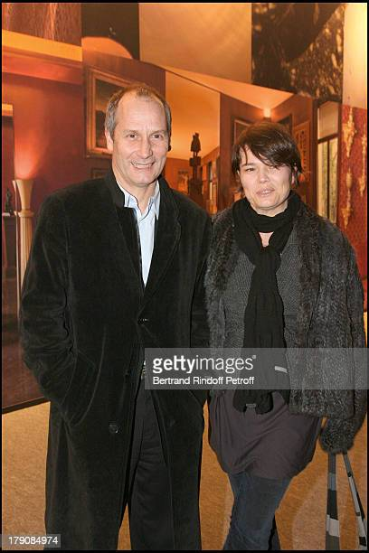 Hyppolite Girardot and wife at Art Collections Of Yves Saint Laurent And Pierre Berge Auction At Grand Palais
