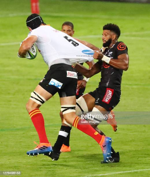 Hyron Andrews of the Cell C Sharks looks to tackle JP du Preez of the Toyota Cheetahs during the Super Rugby Unlocked match between Cell C Sharks and...