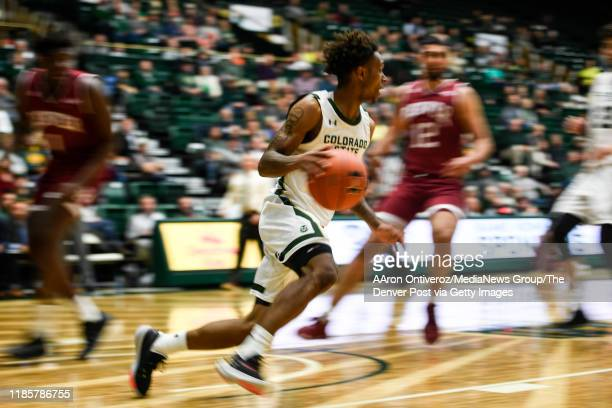 Hyron Edwards of the Colorado State Rams controls the ball against the Denver Pioneers during the second half of CSU's 74-63 win on Tuesday, November...