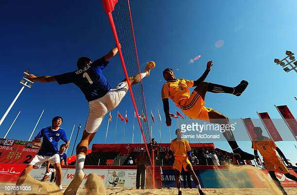 Hyukjin Kwon of South Korea and Mohd Shukri Jaineh of Brunei compete Men's Beach Sepaktakraw Regu Preliminary Pool Match between South Korea and...