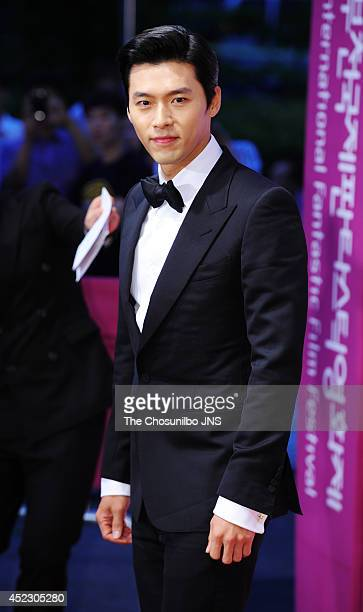 Hyun Bin poses for photographs upon arrival during 18th PiFan opening ceremony at Bucheon gymnasium on July 17, 2014 in Gyeonggi-do, South Korea.