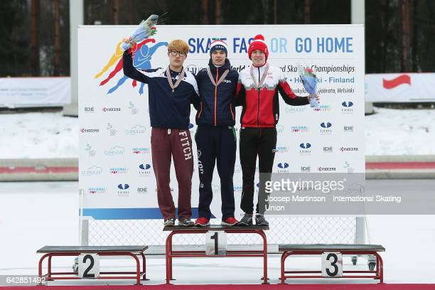 Hyun Min Oh of Korea Chris Huizinga of Netherlands and Graeme Fish of Canada pose in the men's mass start medal ceremony during day three of the...