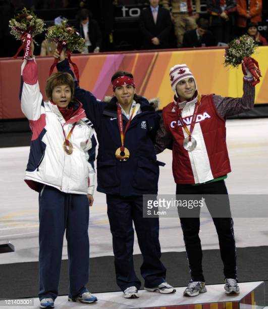 Hyun Soo Ahn Apolo Anton Ohno and Tremblay on the medal stand during the Short Track Speed Skating 500 m at the 2006 Olympic Games held at the...