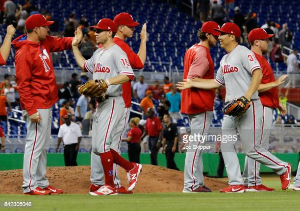 Hyun Soo Kim and Ty Kelly of the Philadelphia Phillies celebrate with teammates after their 12inning 31 win over the Miami Marlins at Marlins Park on...
