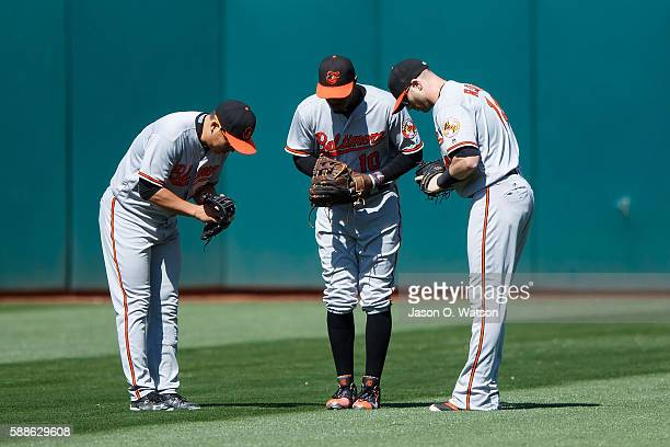 Hyun Soo Kim of the Baltimore Orioles Adam Jones and Nolan Reimold celebrate after the game against the Oakland Athletics at the Oakland Coliseum on...