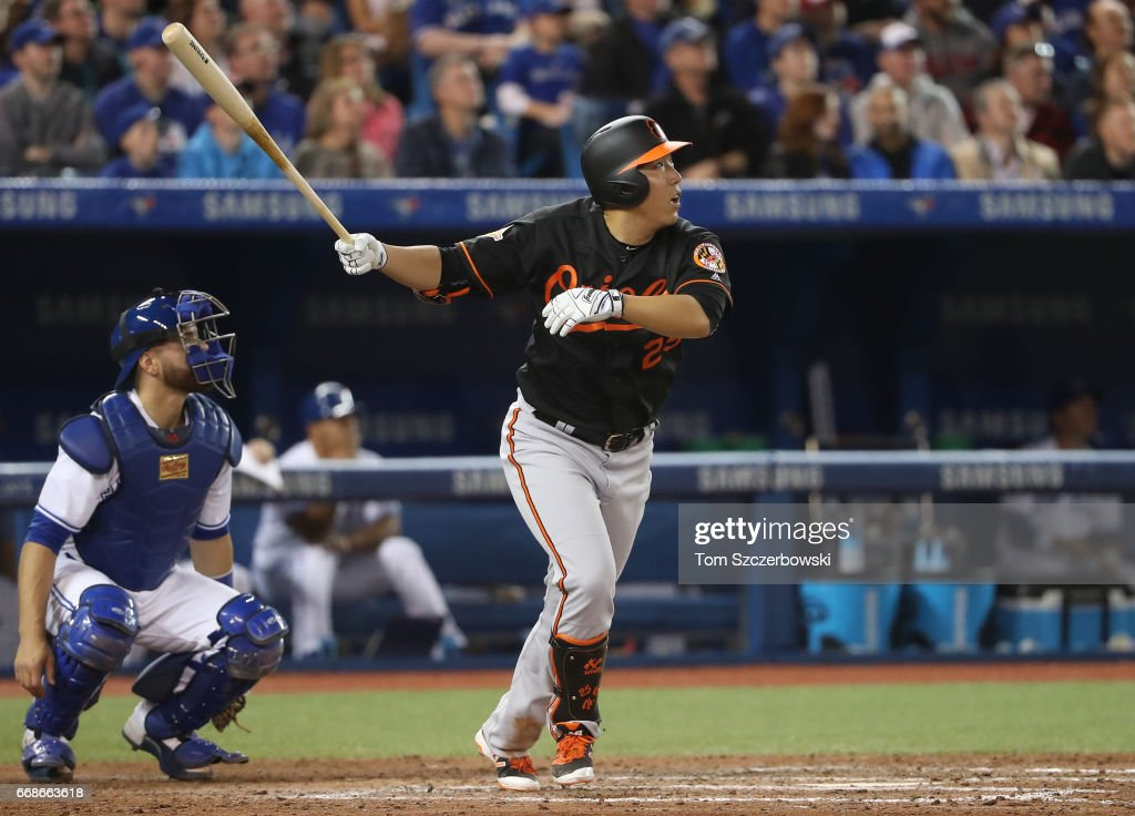 Hyun Soo Kim #25 of the Baltimore Orioles flies out in the eighth inning during MLB game action against the Toronto Blue Jays at Rogers Centre on April 14, 2017 in Toronto, Canada.