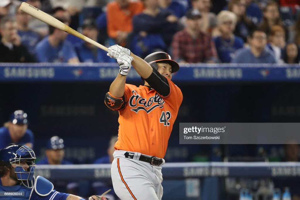 Hyun Soo Kim #25 of the Baltimore Orioles grounds out in the fourth inning during MLB game action against the Toronto Blue Jays at Rogers Centre on April 15, 2017 in Toronto, Canada. All players are wearing #42 in honor of Jackie Robinson Day.