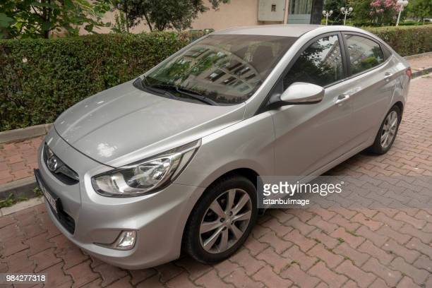 hyundai accent  parked on the street of istanbul - palanquin stock photos and pictures