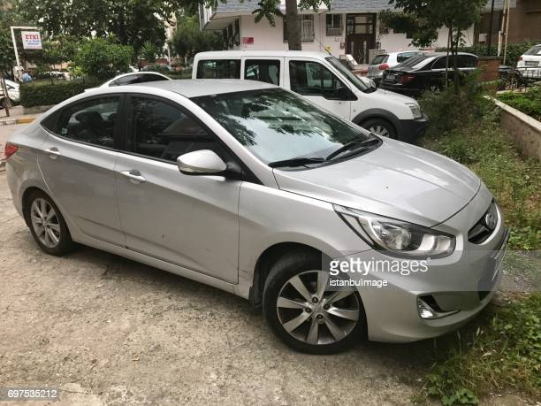 Hyundai accent parking in the street