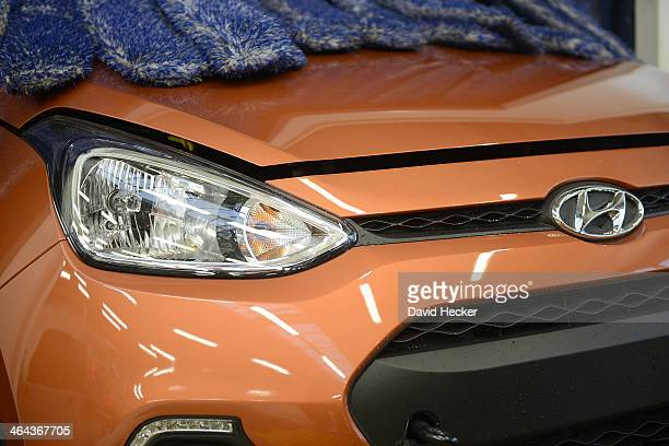 Hyundai car is polished after being unloaded from a ship on January 22 2014 in Bremerhaven Germany Bremerhaven is Europe's biggest port for car...