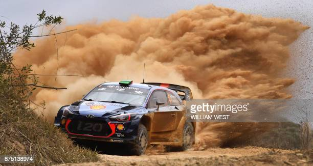 TOPSHOT Hyundai driver Hayden Paddon of New Zealand powers through a corner on the first day of World Rally Championship event Rally Australia near...