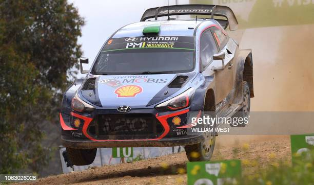 Hyundai driver Hayden Paddon of New Zealand speeds over a brow on the final day of the World Rally Championship Rally Australia near Coffs Harbour on...