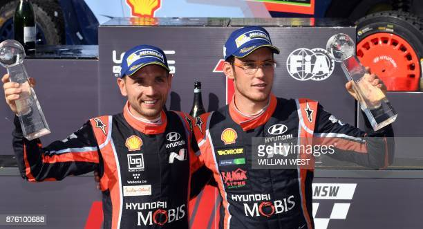 Hyundai driver Thierry Neuville and codriver Nicolas Gilsoul celebrate after winning the World Rally Championship event Rally Australia near Coffs...