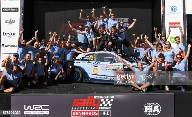 Hyundai driver Thierry Neuville and codriver Nicolas Gilsoul celebrate with their team after winning the World Rally Championship event Rally...