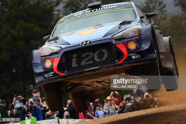 TOPSHOT Hyundai driver Thierry Neuville of Belgium leaps over a jump on the final day of the World Rally Championship event Rally Australia near...