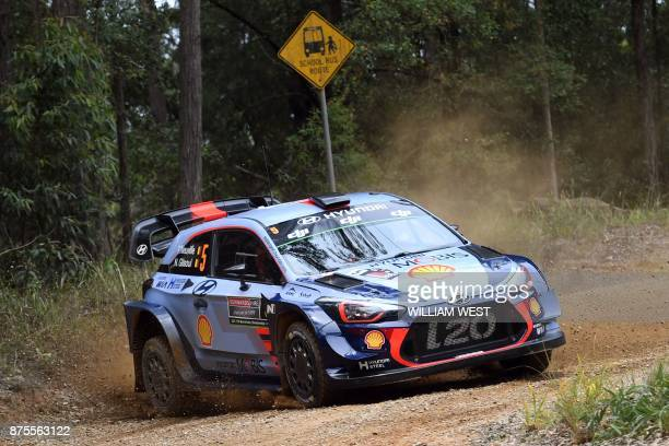 TOPSHOT Hyundai driver Thierry Neuville of Belgium slides through a corner on the second day of World Rally Championship event Rally Australia near...