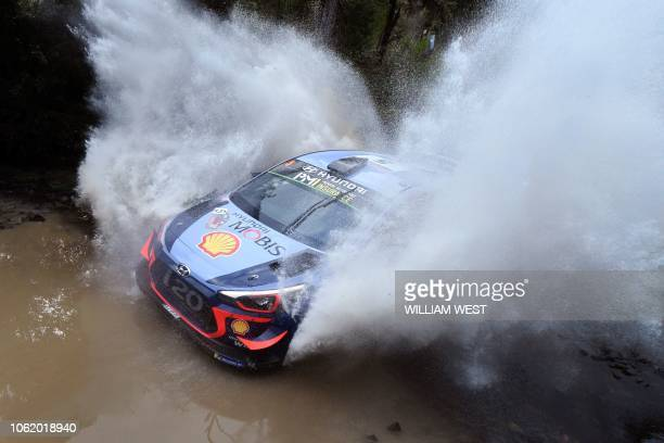 TOPSHOT Hyundai driver Thierry Neuville of Belgium speeds through a creek on the first day of the World Rally Championship Rally Australia near Coffs...