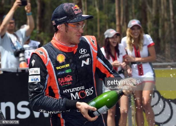 Hyundai driver Thierry Neuville sprays champagne after winning the World Rally Championship event Rally Australia near Coffs Harbour on November 19...