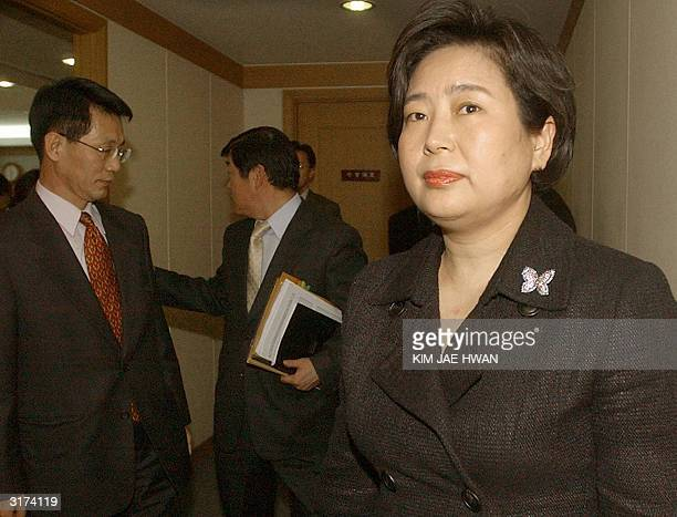 Hyundai group chairwoman Hyun JungEun leaves her office at the group's unit Hyundai Merchant Marine after a news conference in Seoul 31 March 2004...