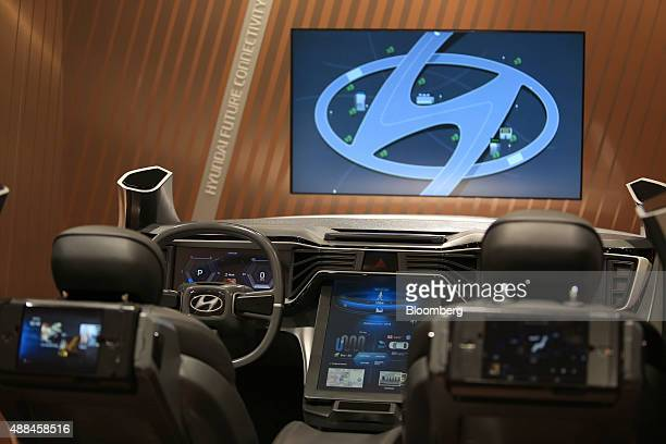 A Hyundai logo is displayed beside a connected incar entertainment simulator at the Hyundai Motor Co exhibition stand during the IAA Frankfurt Motor...