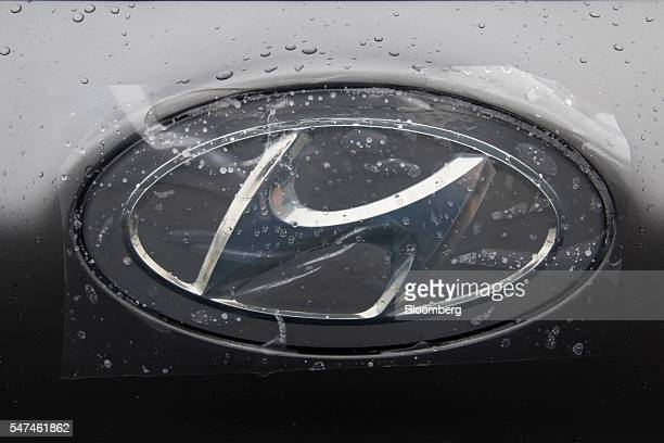 Hyundai Motor Co. Badge displayed on an Ioniq electric vehicle is covered in raindrops at the company's plant in Ulsan, South Korea, on Monday, July...