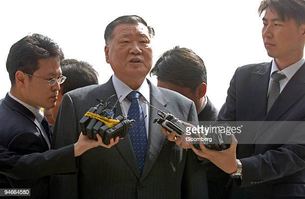 Hyundai Motor Co Chairman Chung Mong Koo answers reporters' questions as he arrives at the Supreme Public Prosecutors' Office in Seoul South Korea...