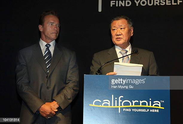 Hyundai Motor Co chairman Chung MongKoo delivers a speech as visiting California Governor Arnold Schwarzenegger looks on during a reception on...