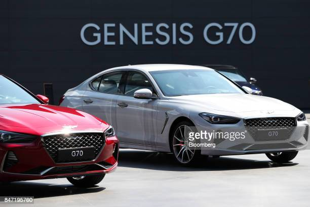 Hyundai Motor Co Genesis G70 sedans stand on display during a launch event in Hwaseong South Korea on Friday Sept 15 2017 The Genesis G70 is...