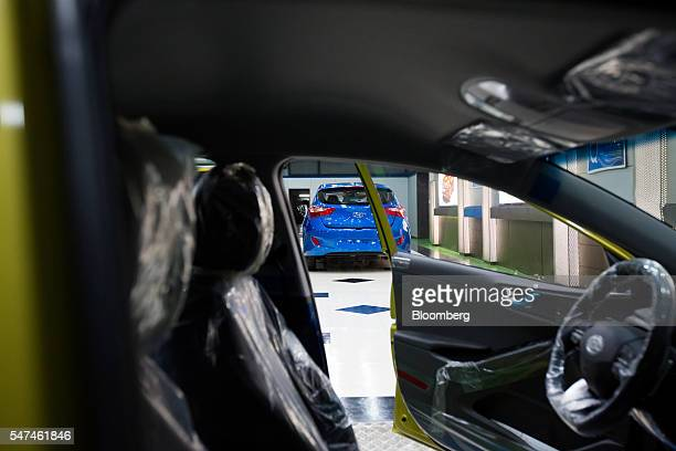 Hyundai Motor Co. I30 vehicle is seen from inside a Hyundai Ioniq electric vehicle on the production line at the company's plant in Ulsan, South...
