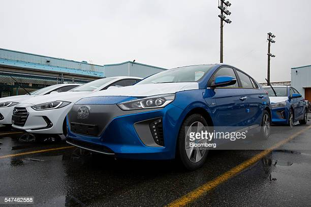 Hyundai Motor Co. Ioniq electric vehicles , right, and Elantra vehicles sit in the company's plant in Ulsan, South Korea, on Monday, July 4, 2016....