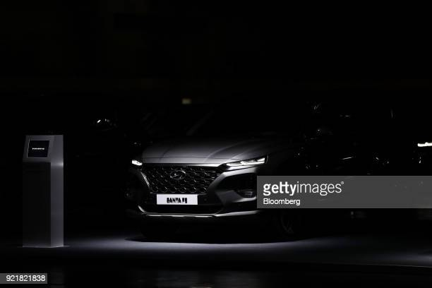 A Hyundai Motor Co newly changed Santa Fe sport utility vehicle stands on display during a launch event in Goyang South Korea on Wednesday Feb 21...