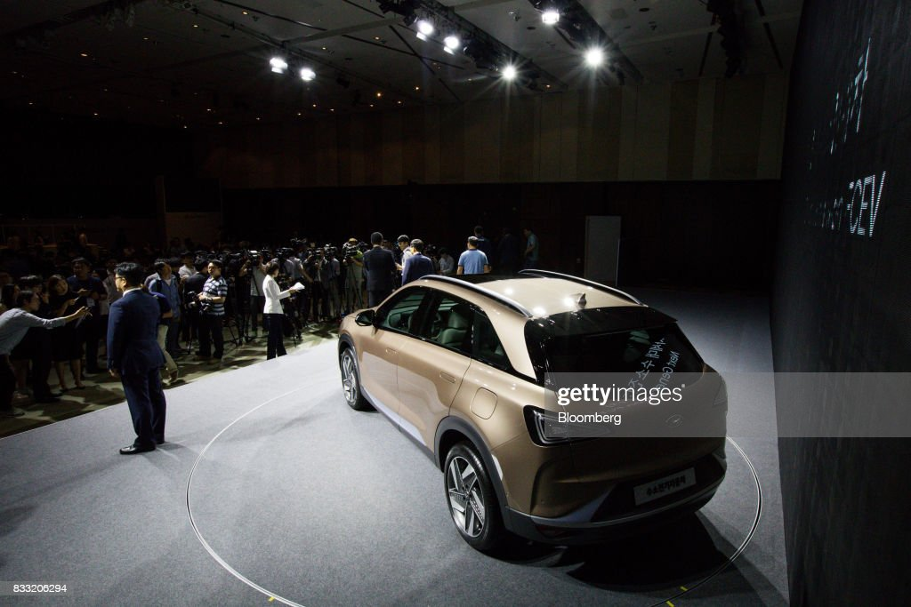 A Hyundai Motor Co. next generation fuel-cell electric sport utility vehicle (SUV) stands on display during an unveiling event in Seoul, South Korea, on Thursday, Aug. 17, 2017. Hyundai said that electric vehicles will underpin its push into environmentally friendly cars, the latest automaker to embrace battery-powered vehicles after earlier bets on hydrogen fuel-cell cars. Photographer: SeongJoon Cho/Bloomberg via Getty Images