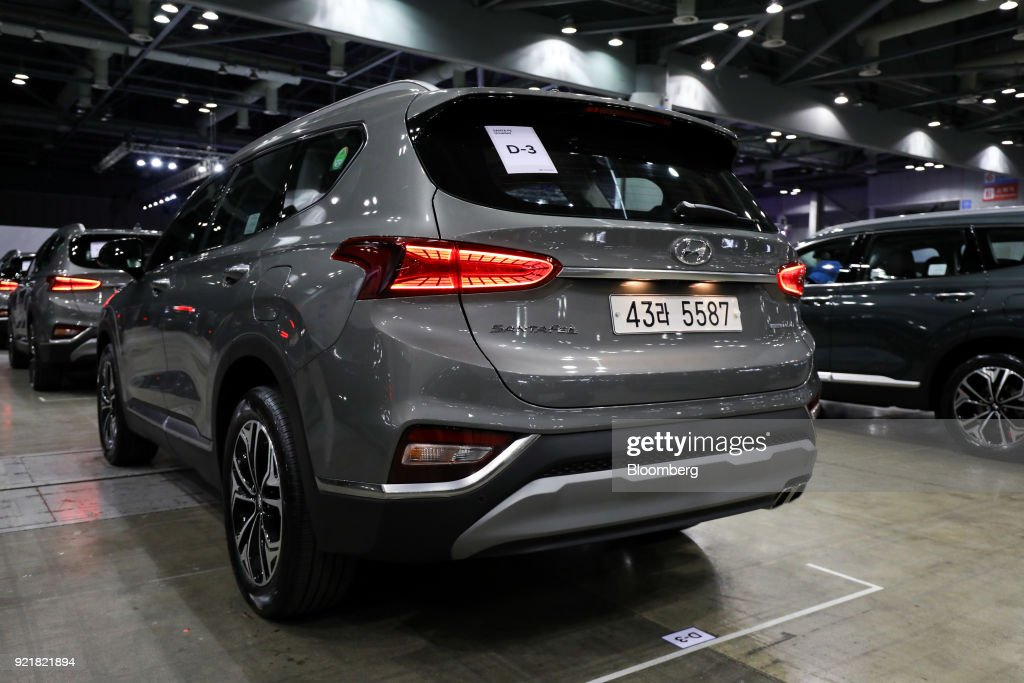A Hyundai Motor Co. Santa Fe sport utility vehicle (SUV) stands on display during a launch event for the updated vehicle in Goyang, South Korea, on Wednesday, Feb. 21, 2018. To recapture buyers in the U.S. who have shunned its sedans and compact cars, Hyundai has said it will bring eight new or redesigned crossovers or SUVs by 2020. Photographer: SeongJoon Cho/Bloomberg via Getty Images
