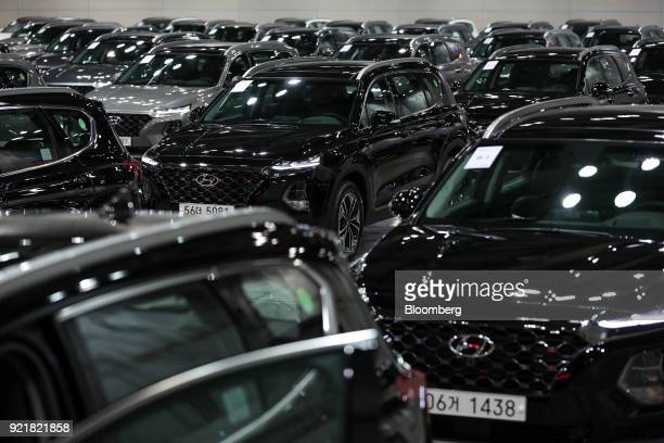 Hyundai Motor Co Santa Fe sport utility vehicles stand on display during a launch event for the updated vehicle in Goyang South Korea on Wednesday...