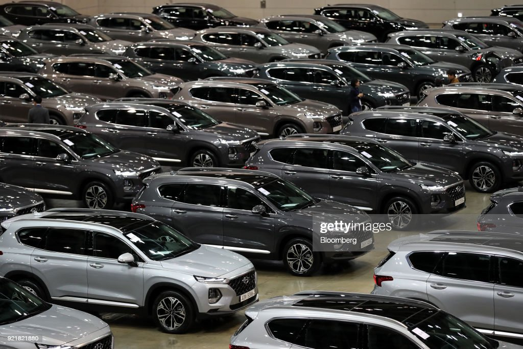 Hyundai Motor Co. Santa Fe sport utility vehicles (SUV) stand on display during a launch event for the updated vehicle in Goyang, South Korea, on Wednesday, Feb. 21, 2018. To recapture buyers in the U.S. who have shunned its sedans and compact cars, Hyundai has said it will bring eight new or redesigned crossovers or SUVs by 2020. Photographer: SeongJoon Cho/Bloomberg via Getty Images