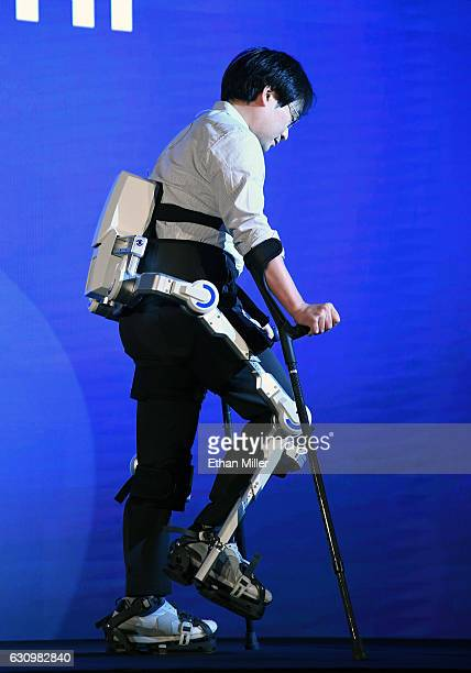 Hyundai Motor Co senior engineer Dr Dong Jin Hyun demonstrates the HMex Hyundai Medical Exoskeleton which is used to assist people who have trouble...