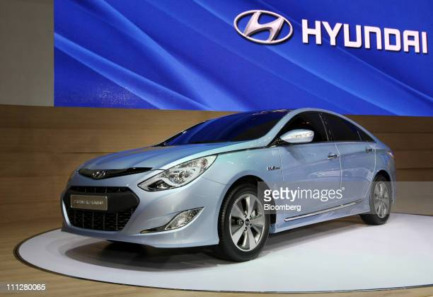 A Hyundai Motor Co Sonata hybrid sedan sits on display during media day at the Seoul Motor Show in Goyang South Korea on Thursday March 31 2011 The...