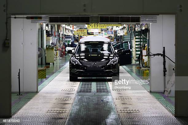 Hyundai Motor Co vehicles await final inspection on the production line at the company's factory in Asan South Korea on Tuesday Jan 20 2015 Hyundai...