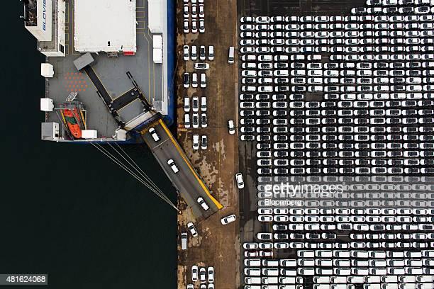 Hyundai Motor Co vehicles bound for export are driven into a Hyundai Glovis Co rollon/rolloff cargo ship at a port near Hyundai Motor's Ulsan plant...
