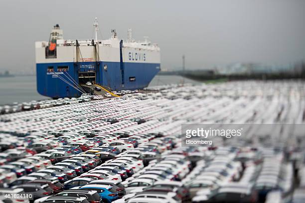 Hyundai Motor Co. Vehicles bound for export are driven into a Hyundai Glovis Co. Roll-on/roll-off cargo ship at a port near Hyundai Motor's Ulsan...