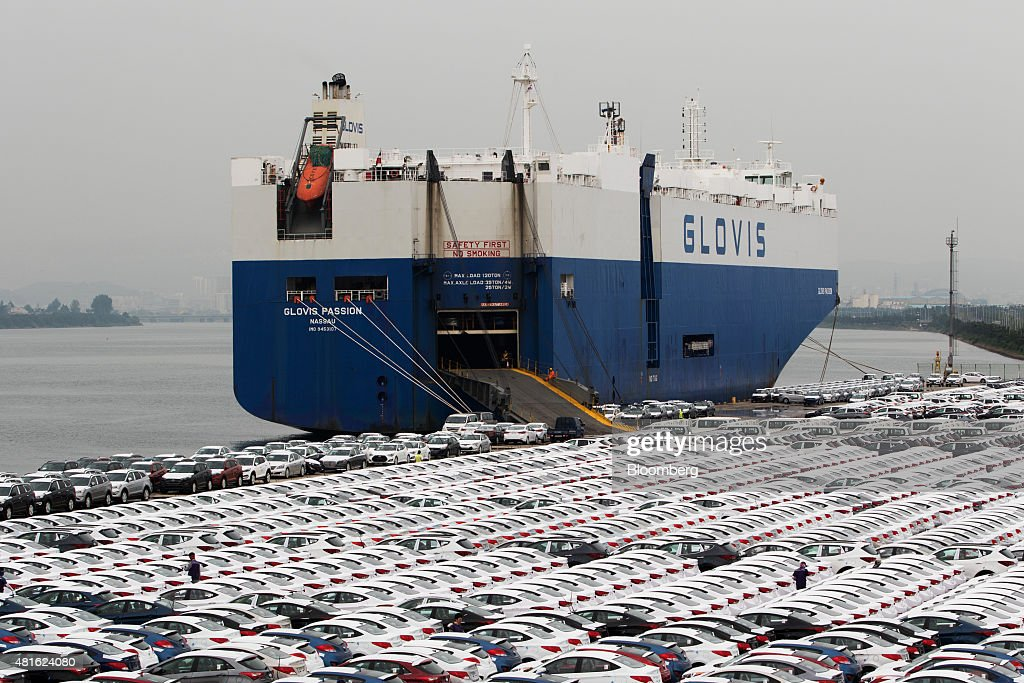 Hyundai Motor Co  vehicles bound for export await shipment next to a
