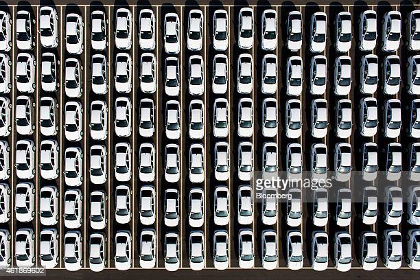 Hyundai Motor Co. Vehicles sit parked at a delivery center at the company's factory in this aerial photograph taken in Asan, South Korea, on Tuesday,...