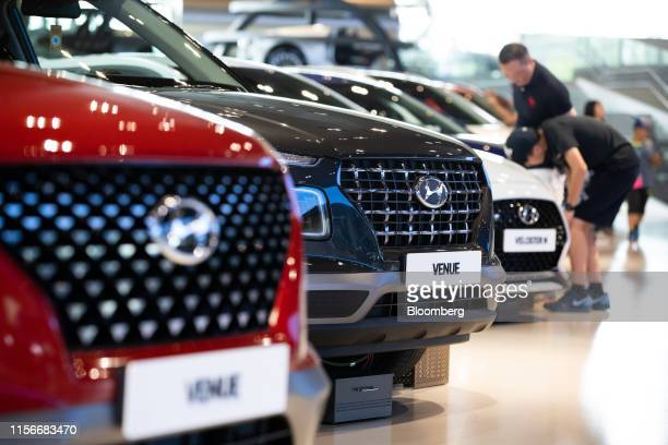 Hyundai Motor Co. Venue compact sport utility vehicle , center, stands on display at the company's Motorstudio showroom in Goyang, South Korea, on...