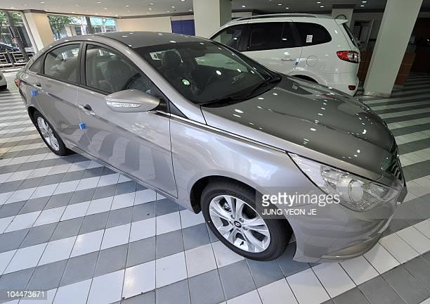 Hyundai Motor's sedan Sonata is displayed at its branch in Seoul on September 27 2010 South Korea's top automaker Hyundai Motor is recalling nearly...