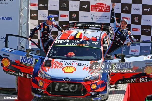 TOPSHOT Hyundai Shell Mobis WRT Belgian driver Thierry Neuville and his Belgian copilot Nicolas Gilsoul celebrate after winning the Tour de Corse...