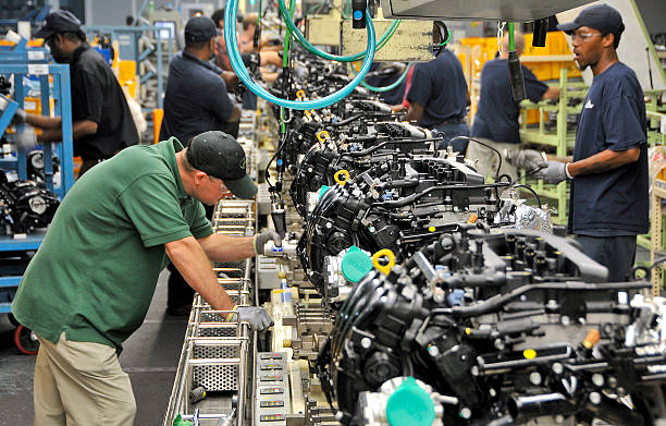 Hyundai team members inspect a batch of 2.4-liter GDI (gas direct-injection