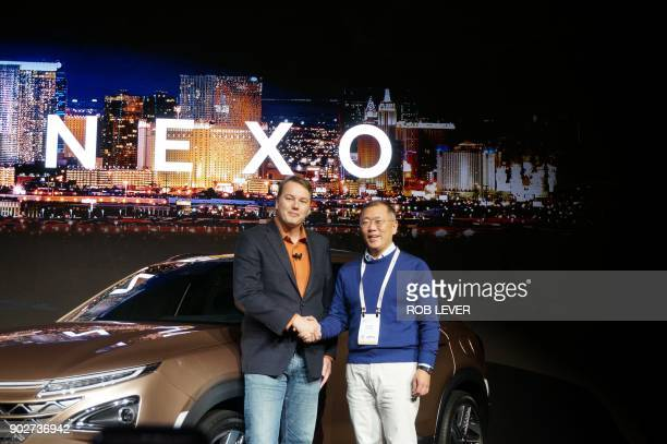 Hyundai vice chairman Eui Sun Chung and Aurora Innovation founder Chris Urmson present the Nexo a hydrogen fuelcell powered vehicle at the...