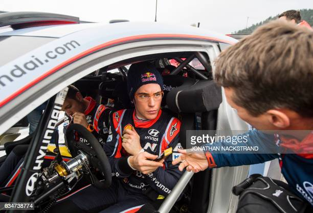 Hyundai's driver Thierry Neuville of Belgium speaks to the press after completing the first round of the day during the Rally Sweden second round of...