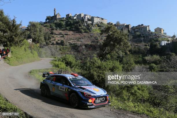 Hyunday Motorsport team's Spanish pilot Dani Sordo and Spanish copilot Marc Marti compete during the shakedown of the Tour de Corse rally stage of...